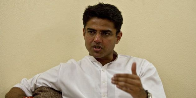 Indian Minister of Corporate Affairs Sachin Pilot gestures during an interview with AFP at his residence...