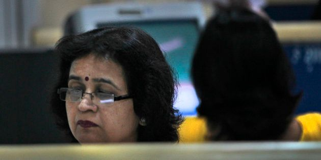 An Indian woman works in an office in New Delhi, India, Thursday, April 19, 2012. The 2 billion women...