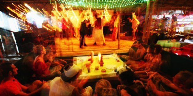 TRIVANDRUM, INDIA - JANUARY 09: Young tourists are dancing at the nightclub disco Funky Art Cafe in Varkala...