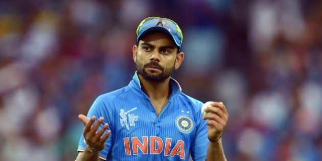 India's Virat Kohli encourages the fans during their 2015 Cricket World Cup match against Pakistan in...