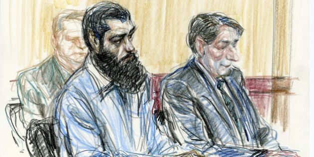 In this courtroom drawing Abid Naseer, front left, sits next to his court-appointed legal adviser James...