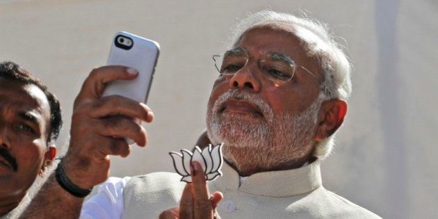 FILE- In this April 30, 2014 file photograph, India's main opposition Bharatiya Janata Party's prime...