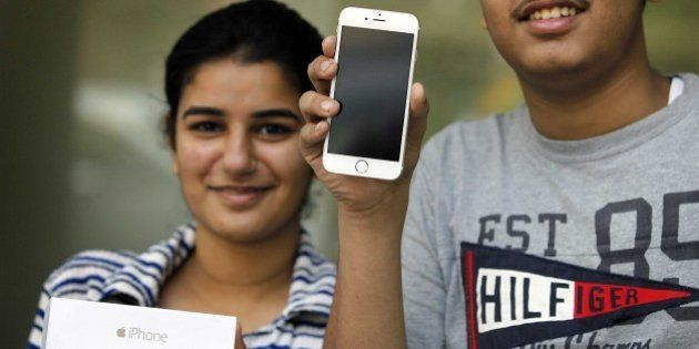 NEW DELHI, INDIA - OCTOBER 17: Apple fans buy newly launched Apple iPhone 6 and iPhone 6 Plus, on October...