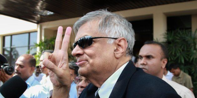 COLOMBO - SRI LANKA - JANUARY 09: Sri Lanka's newly elected Prime Minister Ranil Wickremasinghe flashes...