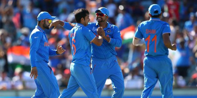 PERTH, AUSTRALIA - MARCH 06: Mohit Sharma and Virat Kohli of India celebrate a wicket during the 2015...