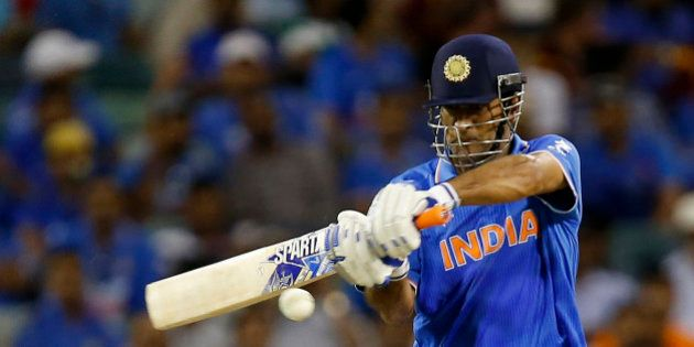 Indian batsman M S Dhoni plays a shot during their Cricket World Cup Pool B match against the West Indies...