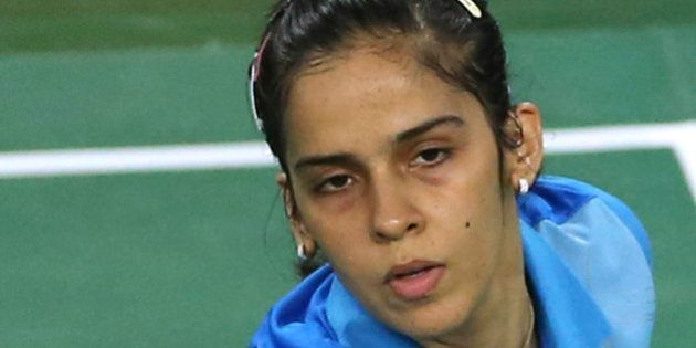 India's Saina Nehwal returns a shot to South Korea's Sung Ji-hyun during the women's Badminton team semifinal...