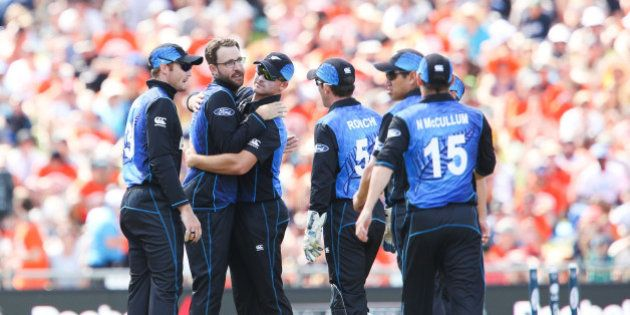 NAPIER, NEW ZEALAND - MARCH 08: Daniel Vettori of New Zealand is congratulated on taking his 300th career...