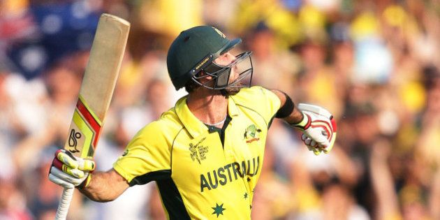 Australia's Glenn Maxwell celebrates after scoring a century while batting against Sri Lanka during their...