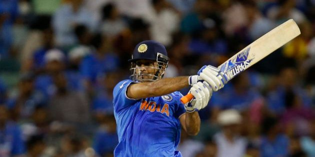 Indian batsman M S Dhoni watches his shot during their Cricket World Cup Pool B match against the West...