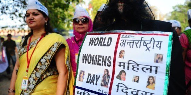 Indian members of the Akhil Bhartyia Agnishikha Manch group and nuns take part in a peace-rally to mark...
