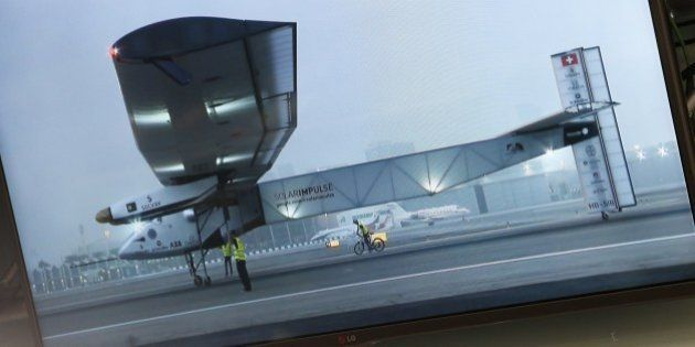 A live video feed of the Solar Impulse 2 solar powered aircraft is pictured on a screen at the mission...