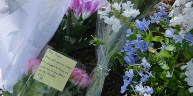 Flowers are laid in a Sydney park on March 9, 2015, on the spot where a mother from India, IT professional...
