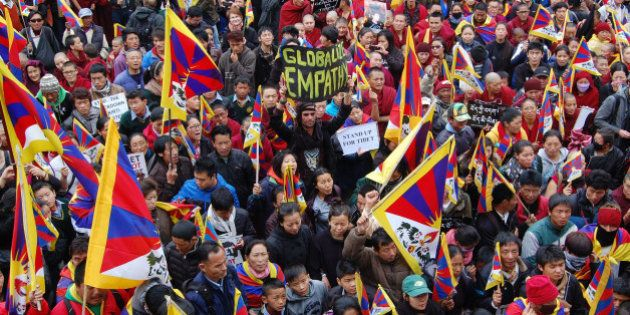 DHARAMSALA, INDIA - MARCH 10: Members of the Tibetan Youth Congress take part in a demonstration to mark...