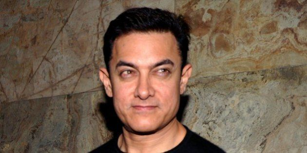 Indian Bollywood actor Aamir Khan attends a special screening of Hindi film 'PK' in Mumbai on December...