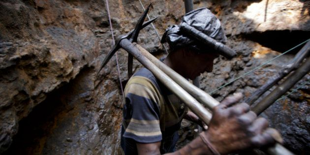 MEGHALAYA, INDIA- APRIL 30: A coal miner walks out of a mine in Jaintia Hills, Meghalaya in India on...