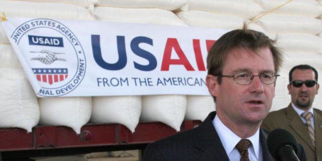 Amman, JORDAN: US ambassador to Jordan David Hale speaks to reporters in front of bags of wheat in Amman...