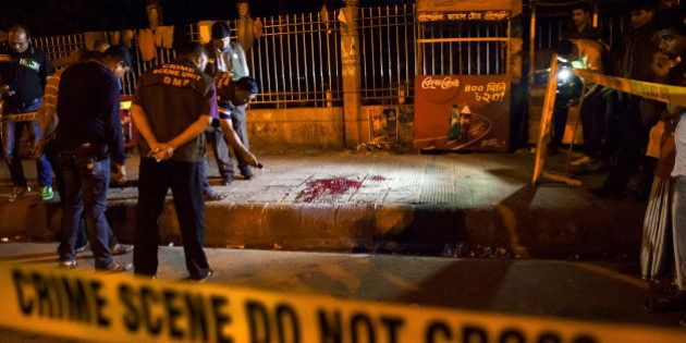 In this Thursday, Feb. 26, 2015, photo, Bangladeshi policemen investigate at the site of attack on Avijit...