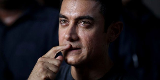 Bollywood actor Aamir Khan gestures during a media interaction on completion of his 25 years in Indian...