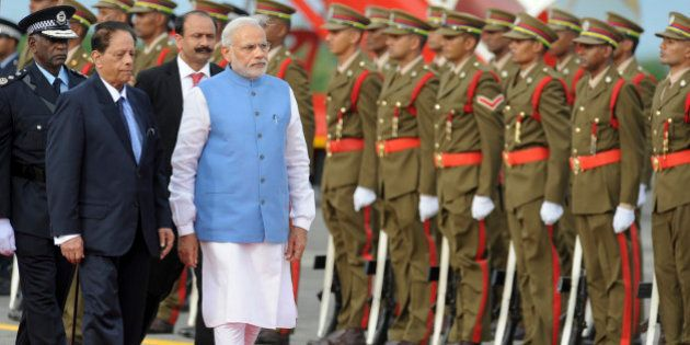 India's Prime Minister Narendra Modi, center-left, inspects an honour guard accompanied by Prime Minister...