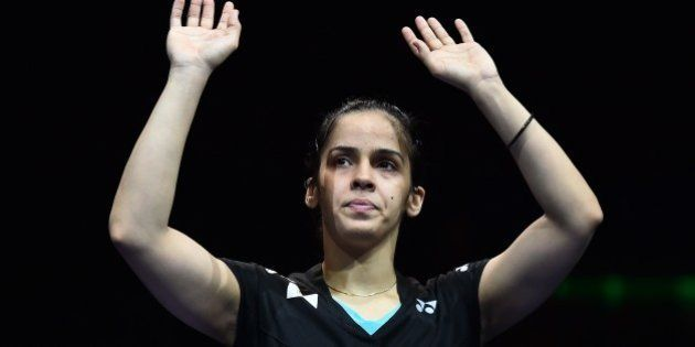 India's Saina Nehwal waves to the crowd after being defeated by Spain's Carolina Marin (not pictured)...