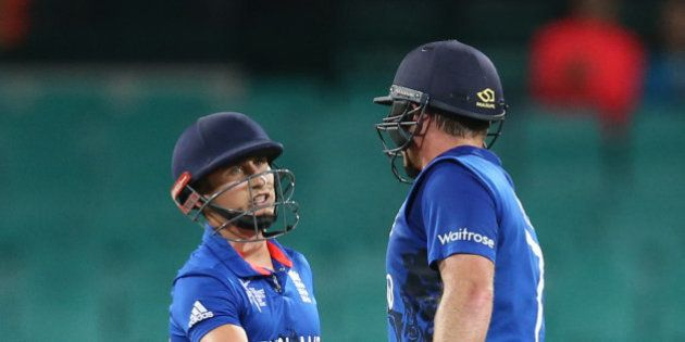 England's James Taylor, left, congratulates teammate Ian Bell for completing a half century during their...