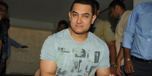 Indian Bollywood film actor, director, producer and television presenter Aamir Khan celebrates his 50th...