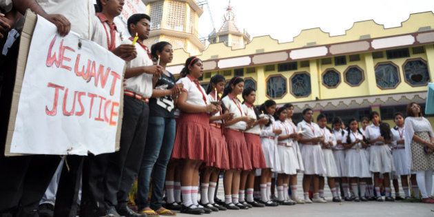 Students of Convent of Jesus and Mary School participate in a protest against the gang rape of a nun...