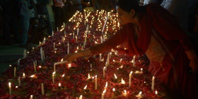 Activists of Pakistani civil society light candles for victims of suicide bomb attacked on churches,...