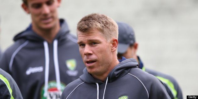 BIRMINGHAM, ENGLAND - JUNE 12: David Warner (R) of Australia warms up pre match alongside captain George...