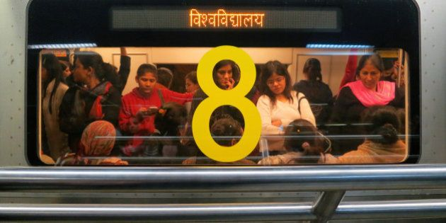 Indian women travel inside a crowded Women Only metro train compartment in New Delhi, India, Saturday,...