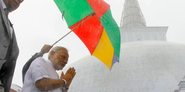 Indian Prime Minister Narendra Modi folds his hands in a sign of respect during his visit to Ruwanwelisaya,...