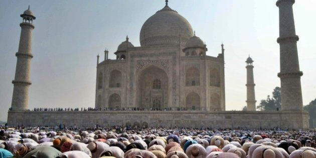 Indian Muslims offer prayers during Eid al-Adha, or the Feast of the Sacrifice, at the Taj Mahal monument...