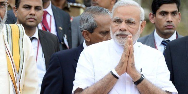 Indian Prime Minister Narendra Modi (R) and the Sri Lankan chief minister of the northern province C....