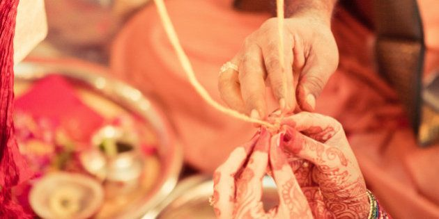 Thali / mangalasutra is a sacred thread that a Hindu groom ties around the bride's neck which identifies...