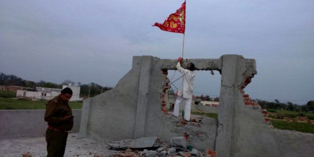 HISAR, INDIA - MARCH 16: A red flag hoisted on an under construction church that was vandalized by some...