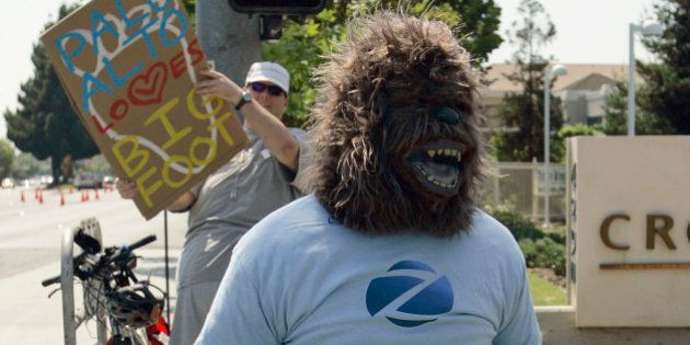 FILE - In this Friday, Aug. 15, 2008 file photo, taken in Palo Alto, Calif., a man in an ape costume...