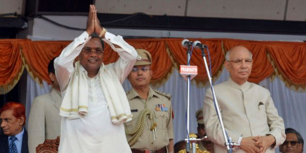 India's ruling Congress party leader and new Chief Minister of Karnataka state K. Siddaramaiah, left,...