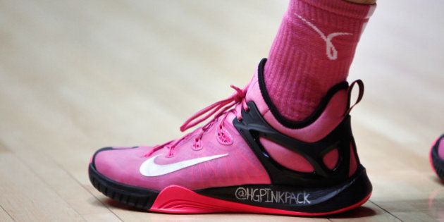 The shoe of New Mexico starting guard Hugh Greenwood displays the name of his twitter account to raise...