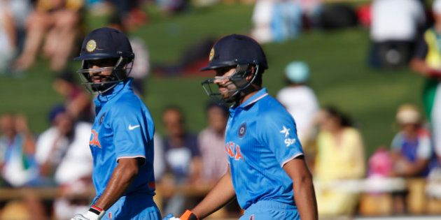 India's Shikhar Dhawan left, and Rohit Sharma walk onto the field to start the Indian batting attack...