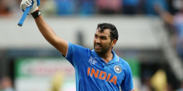 India's Rohit Sharma celebrates after scoring a century while batting against Bangladesh during their...