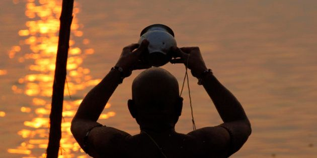 ALLAHABAD, INDIA - 2015/03/02: Hindu devotee offering prayers after takes holy bath in the Sangam confluence...