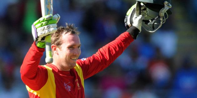 Zimbabwe's Brendan Taylor celebrates after scoring a century while batting against India during their...