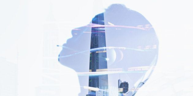 Woman's silhouette in reflection of city