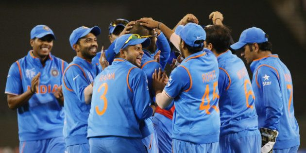 Indian players celebrate the dismissal of Bangladesh's Mahmudullah during their Cricket World Cup quarterfinal...