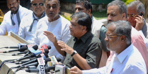 Indian leaders and members of the opposition in the Karnataka State Legislative Assembly, gather outside...
