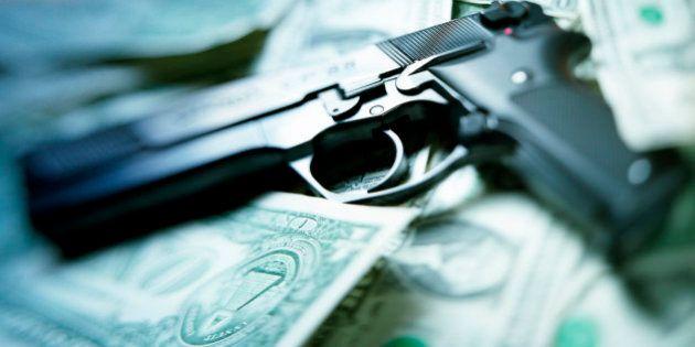 pistol lying on dollar