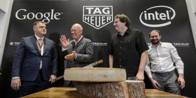 (L TO R) Swiss watchmaker Tag Heuer Director General Guy Semon, Tag Heuer CEO Jean-Claude Biver, Intel's...
