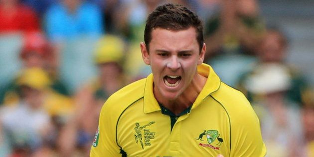 Australia's Josh Hazlewood celebrates after taking the wicket of Pakistan's Ahmad Shahzad during their...
