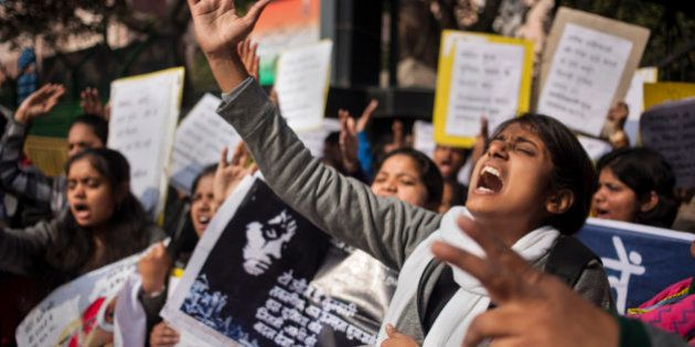 An Indian woman shouts slogans during a protest outside police headquarters against alleged police negligence...